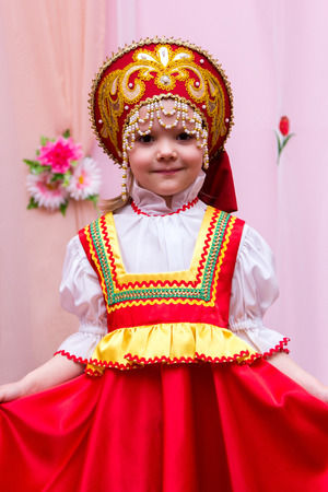 little girl in a red Russian national dress Stock Photo