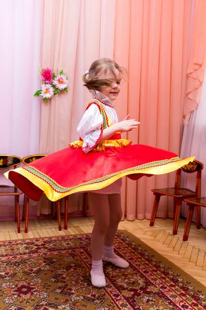 kokoshnik: little girl in a red Russian national dress Stock Photo