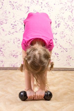 cute little girl with a dump bell