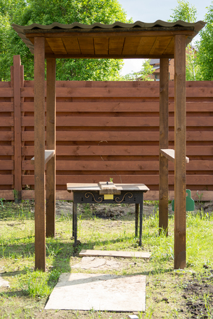 brazier: brazier with a cap under a wooden canopy Stock Photo