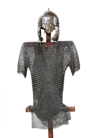 ancient chain armor and helmet isolated on white background