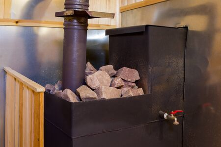iron stove with stones in a Russian bath