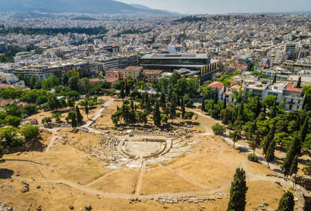 Ancient theater of Dionysus ruins and Athens panorama