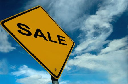 Colourful Sale Sign, set against a stunning sky photo