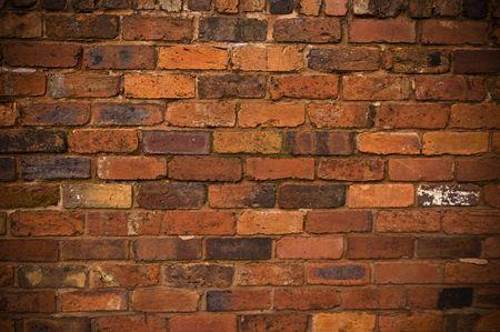 paredes de ladrillos: The rough ladrillos de una vieja pared de ladrillo, hace un gran fondo