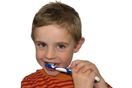 An Isolated photo of a Child (5) brushing his teeth photo