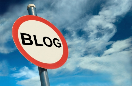A Colourful Blog sign against a Cloudy Sky Stock Photo - 5569148
