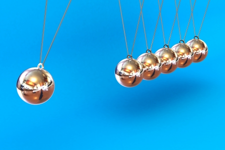 A Colourful 3d Rendered Newtons Cradle Illustration on a Blue Background illustration