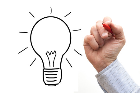Male hand drawing light bulb over a White Background  photo