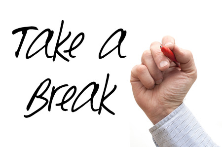 take a note: A Photo  Illustration of a Hand Writing Take a Break