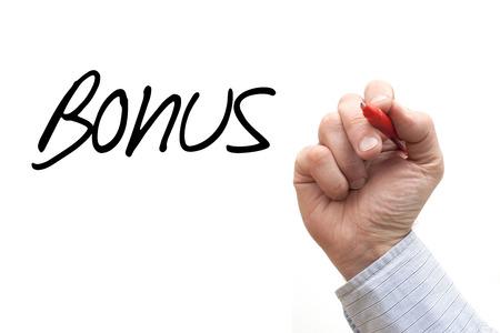 A Photo  Illustration of a Hand Writing Bonus Stock Photo