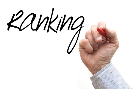 backlink: A Photo  Illustration of a Hand Writing Ranking