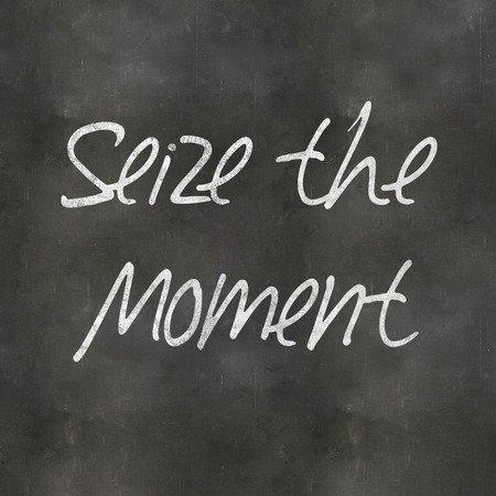 seize: A Colourful 3d Rendered Concept Illustration showing Seize the Moment written on a Blackboard