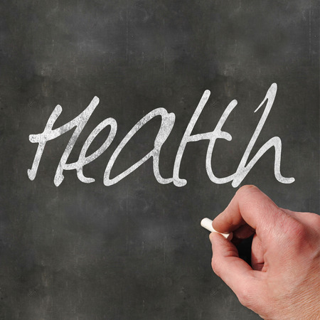 writting: A Colourful 3d Rendered Concept Illustration showing a hand writting Health on a blank blackboard Stock Photo
