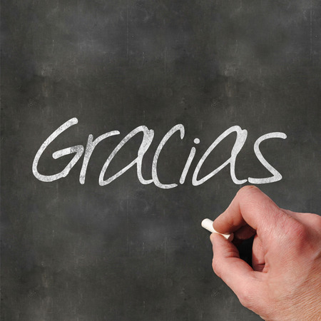 writting: A Colourful 3d Rendered Concept Illustration showing a hand writting Gracias on a blank blackboard