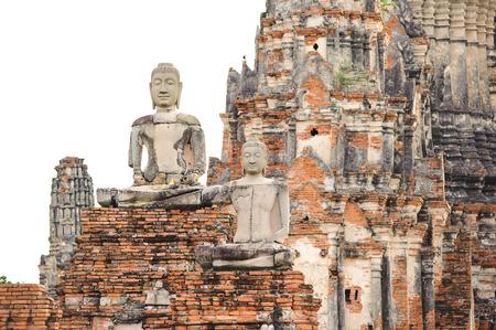 Ruined Budhas in thai pagoda background at Wat Chaiwattanaram Auydhaya Thailand photo