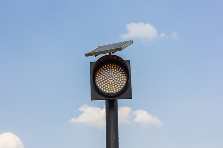 solarcell: Traffic lights in front of blue sky.