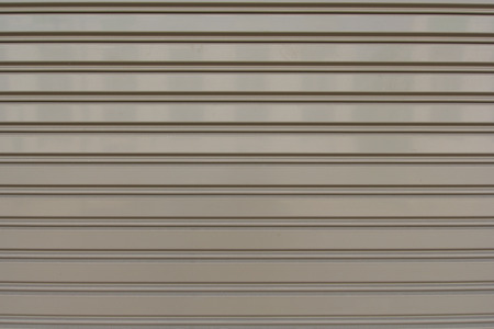 Metal roller shutter use as background. photo