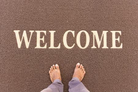 bienvenida: El nuevo felpudo de texto de bienvenida. Foto de archivo