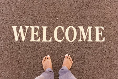 The new doormat of welcome text. Stock Photo