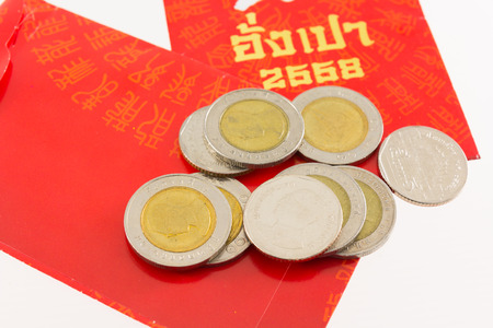 red packet: Thai money coin with Chinese New Year 2015 red packet.