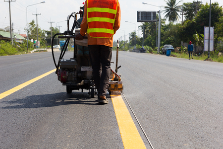 budget repair: Machine eject and worker on road and traffic sign painting.