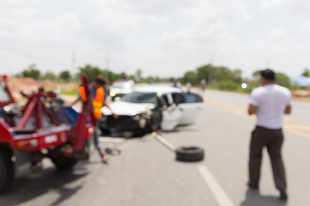damaged cars: De focused car accident on road, insurance.