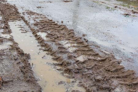 tyre tread: Tire tracks on the ground.