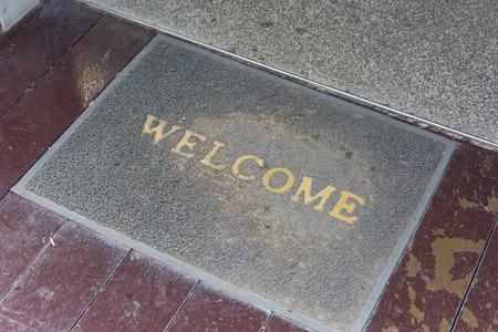 doormat: The old doormat of welcome text.
