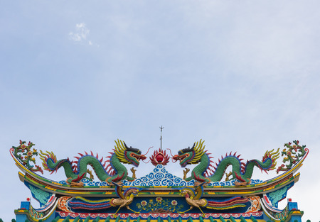 vigor: chinese style dragon statue on blue sky background.