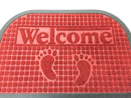 doormat: The new doormat of welcome text. Stock Photo