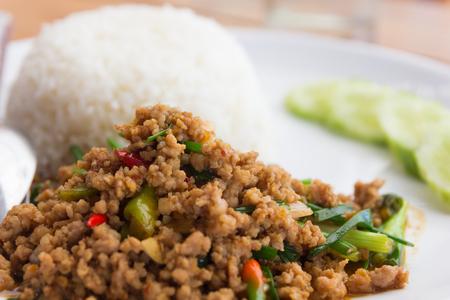 Close up rice with stir-fried pork and basil. 写真素材