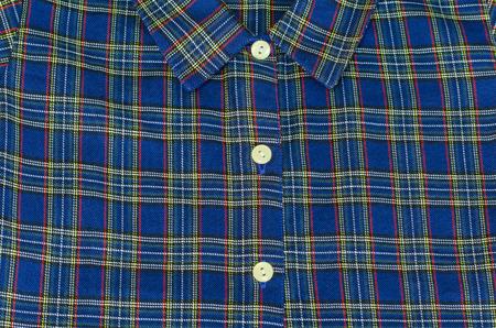 collared shirt: Mans blue cotton plaid shirt in thailand