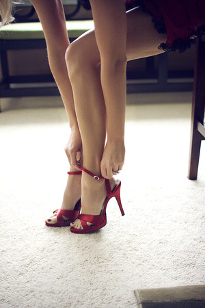 ankles sexy: sexy legs in red shoes Stock Photo
