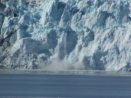 disenchantment: A chunk of ice calving off of Hubbard Glacier into Disenchantment Bay.  Taken off of the Alaska coast. Stock Photo