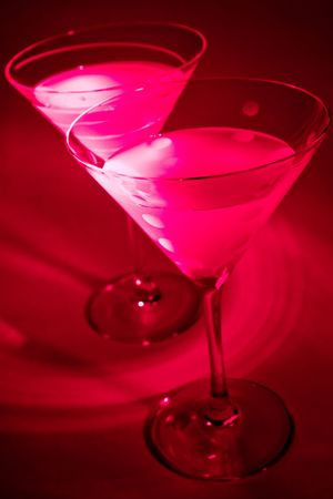 barware: Cosmopolitan Martinis on Red background Stock Photo