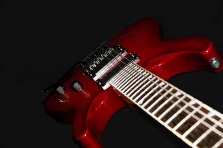 Red Electric Guitar on Black Background photo