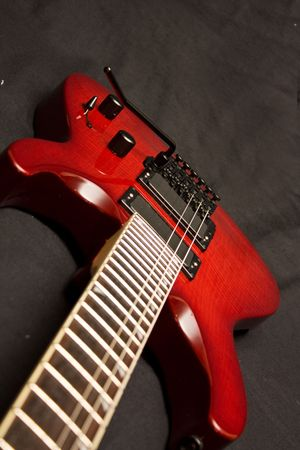 Red Electric Guitar on Black Background