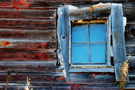 home destruction: Blue window on side of old red building