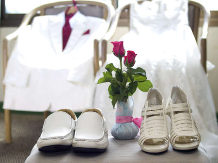 Wedding dress, tuxedo and wedding shoes photo