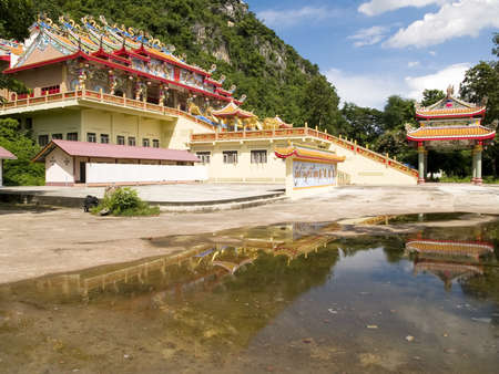 Chinese temple and the backdrop of the mountain sky photo