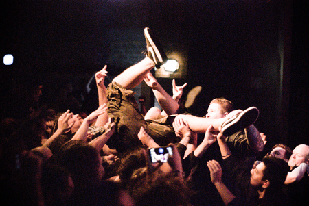 Crowdsurfer at a heavy metal concert