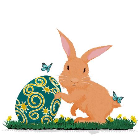 hold: Rabbit hold easter egg on grass
