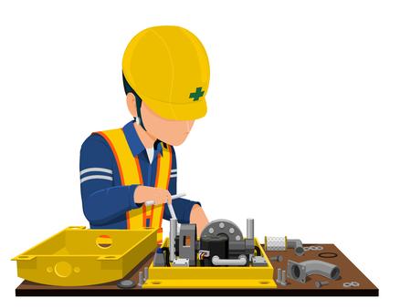 Worker assembling a machine.