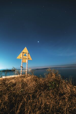 Night view of the starry sky by the lake. Stock Photo