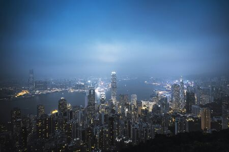 A view of the city at night from the top of the Taiping mountain in Hong Kong. Stock Photo