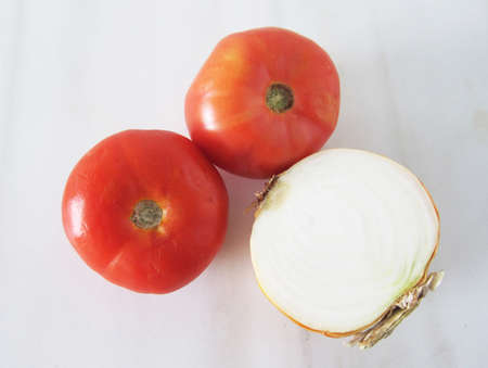 Tomato and onion on white background Stock Photo