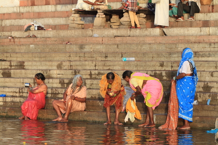 reincarnation: The Holy bath in the river of Varanasi