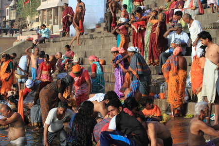 reincarnation: Holy bath in the River of Varanasi India