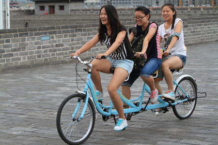 3 Young Chinese Girls are Cycling